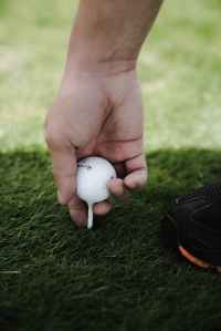 person holding golf ball